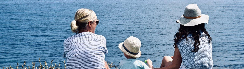 Family overlooking sunny beach