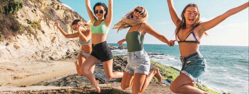 Girls happy jumping on beach